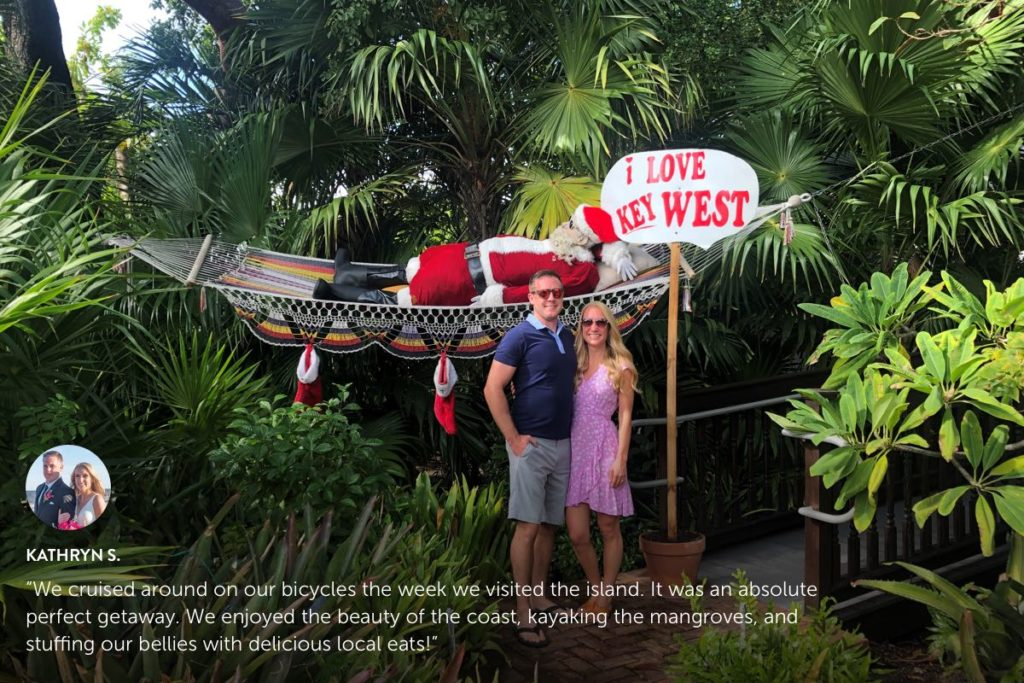 Photo submission from Kathryn S. standing in front of palm trees in Key West.