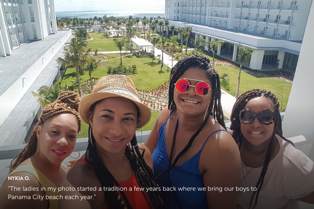 Photo submission from Nykia O. showing 4 african american females enjoying the sun on a hotel balcony