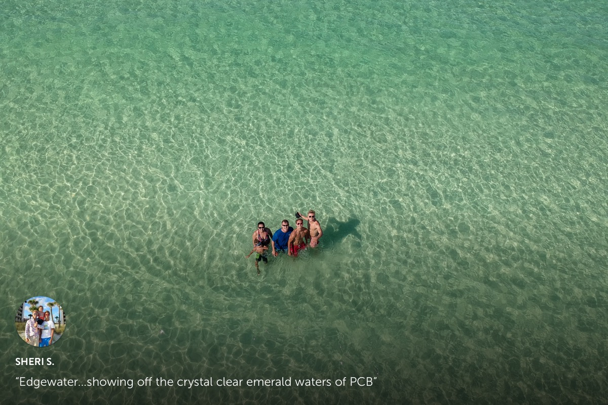 Photo submission from Sheri S. a family of 4 standing in the middle of crystal clear waters of a beach